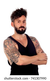 Thoughtful handsome man with tattoos isolated on a white background