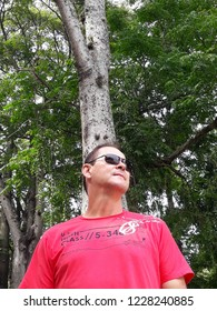 Thoughtful, homesick man, remembering good times, amidst nature