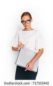 Thoughtful lady poses with folder in her arms