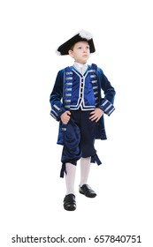 Thoughtful little boy wearing blue musketeer costume. Isolated on white