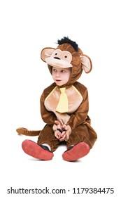Thoughtful little boy wearing like monkey. Isolated on white