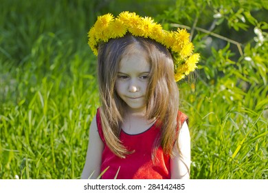 thoughtful little girl in floral wreath