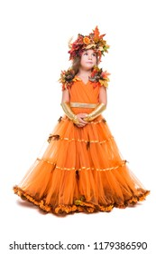 Thoughtful little girl wearing orange autumn dress and wreath. Isolated on white