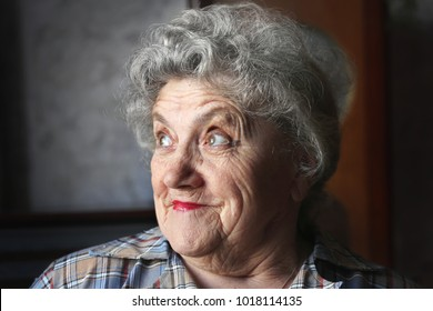Thoughtful and looking elderly woman