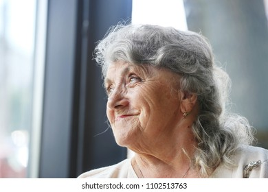 Thoughtful and looking grandmother face