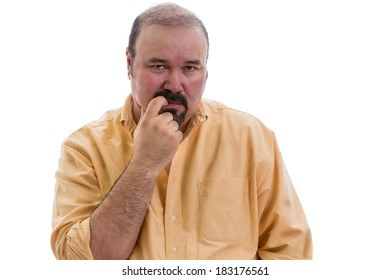 Thoughtful man chewing his finger as he debates a problem staring straight ahead with a serious expression, part of a series on body language, isolated on white