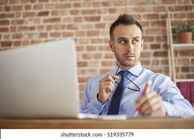 Thoughtful man in front of his desk