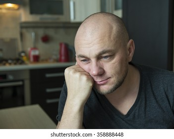 Thoughtful man in the interior of his house