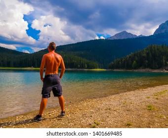 Thoughtful Man in the Nature Portrait. In the Black Lake (Crno Jezero), Zabljak, Montenegro