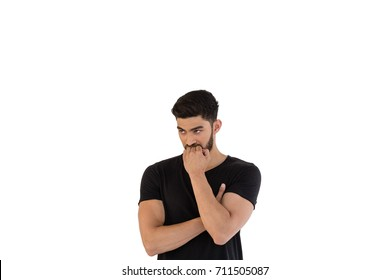 Thoughtful man posing with arms crossed against white background
