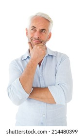 Thoughtful man posing with hand on chin on white background