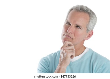 Thoughtful mature man looking away isolated over white background