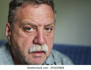 Thoughtful mature man portrait