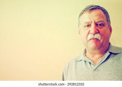 Thoughtful mature man portrait. Grunge stye