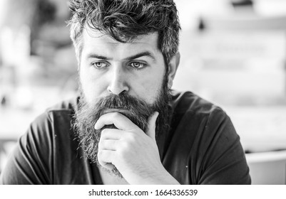 Thoughtful mood concept. Making important life choices. Making hard decision. Man with beard and mustache thoughtful troubled. Bearded man concentrated face. Hipster with beard thoughtful expression.