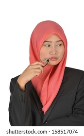 Thoughtful muslim malay business woman holding glasses , isolated on white background