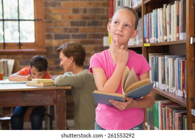 Thoughtful pupil at library at elementary school