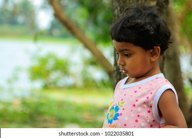 Thoughtful and sad little girl