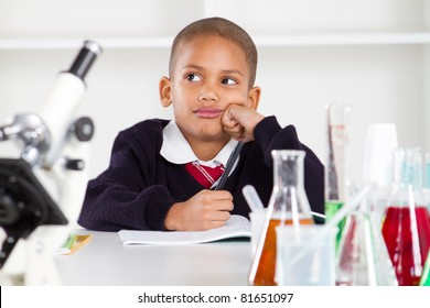 thoughtful science boy in lab