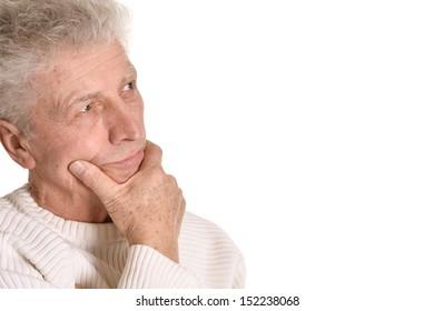Thoughtful senior man isolated on white background