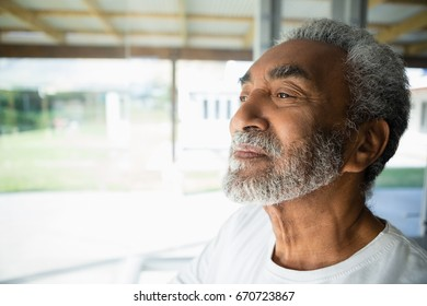 Thoughtful senior man relaxing at home