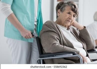 Thoughtful senior woman on a wheelchair