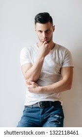 Thoughtful sexy man posing in studio on white background