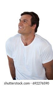 Thoughtful smiling mature man looking away against white background