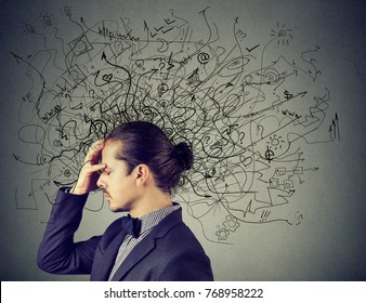 Thoughtful stressed man with a mess in his head