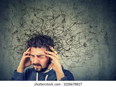 Thoughtful stressed young man with a mess in his head