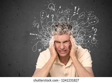 Thoughtful stressed young man with a mess