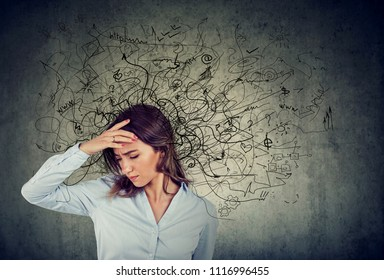 Thoughtful stressed young woman with a mess in her head