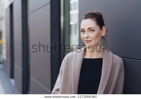 Thoughtful Stylish Young Woman Standing Leaning Stock Photo