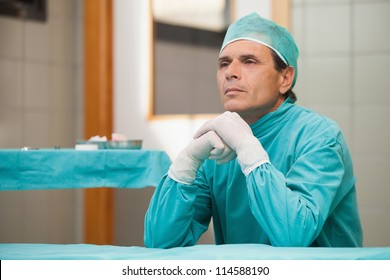 Thoughtful surgeon sitting in a operating theater in a hospital
