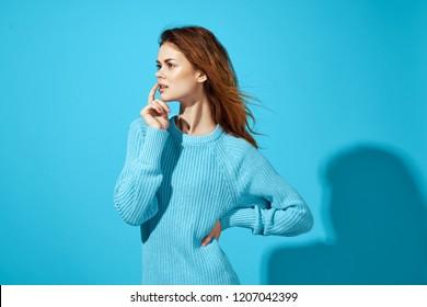 thoughtful woman in blue sweater