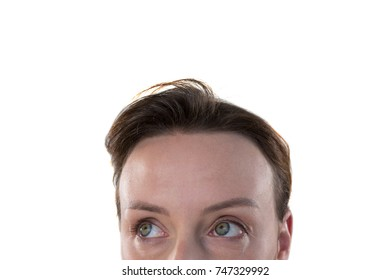 Thoughtful woman looking away against white background