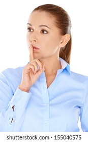 Thoughtful worried young woman with her finger raised to her lips staring off into space with a wide eyed expression  upper body isolated on white