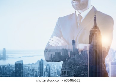 Thoughtful young businessman on creative New York city background. Employment concept. Double exposure