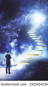 Thoughtful young businessman standing next to ladder leading to success on starry night sky background. Ambition and research concept