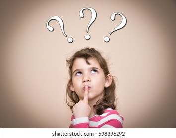 Thoughtful young girl with three question marks above her head