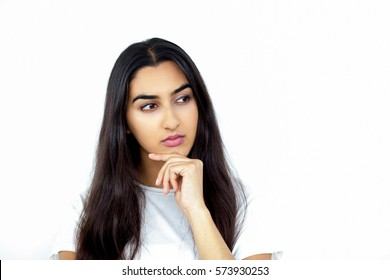 Thoughtful young Indian woman looking aside