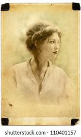 thoughtful Young lady in old photo card damaged by time