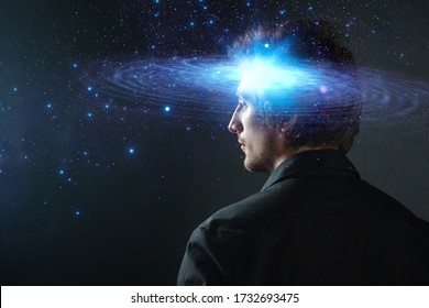 Thoughtful young man, creative mind concept. A man with a galaxy in his head, complex human consciousness and psychology, inner space