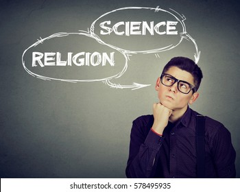 Thoughtful young man making up his mind science or religion