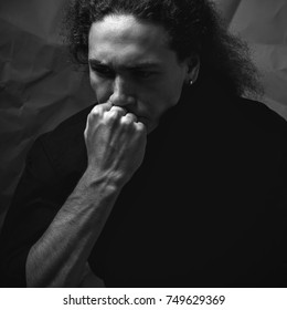 A thoughtful young man. Studio. Black and white