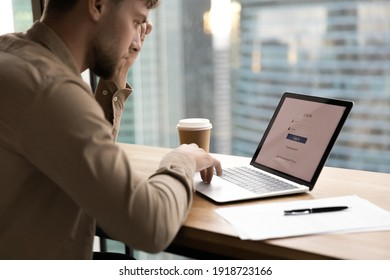 Thoughtful young man worker, student sit by laptop, prepare to input personal data entering account. Pensive millennial guy creating strong login password to electronic bank. Close up