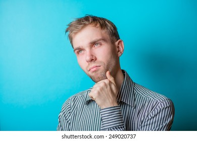 Thoughtful young men looking at camera and holding his hand on chin. young casual man
