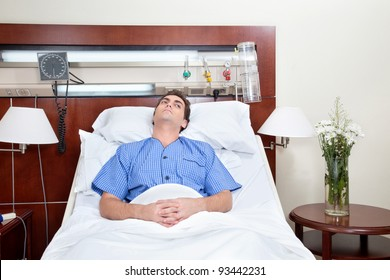 Thoughtful young patient lying on bed in hospital