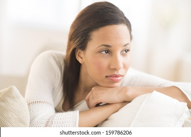 Thoughtful young woman with hand on chin
