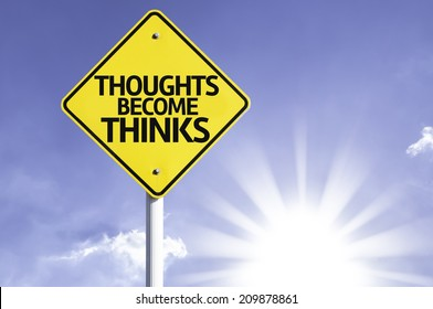 Thoughts Become Thinks road sign with sun background